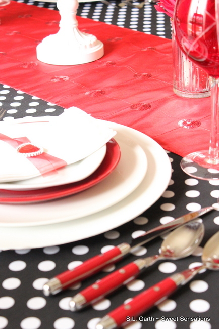 Polka dots for Valentine's Day with the right color palette and accessories work great.