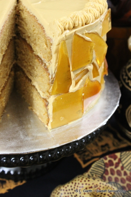 With its amber colored sugar shards as decorations this Dulce de Leche Cake is everything a decadent dessert should be. Serve it for a special occasion or just treat yourself because you deserve it.