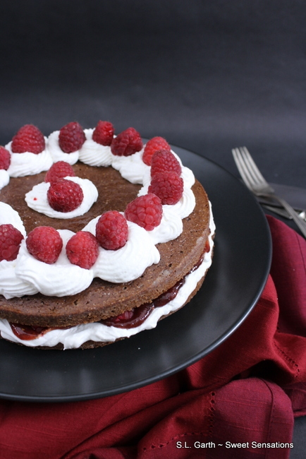 How does a Chocolate Raspberry Cake with whipped topping and raspberry fruit preserves between the layers sound to you?