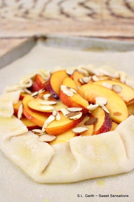 What better way to use the bounty of summer stone fruit than with this Peach Galette with Almonds.