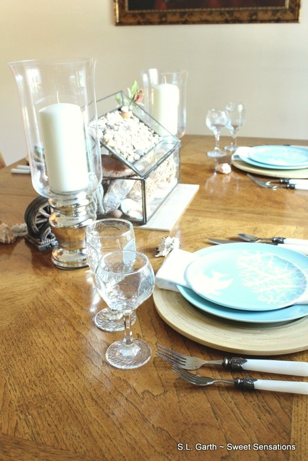 You may find that you have more coastal table décor than you can use on one table. If that's the case stretch those pieces into two different designs.