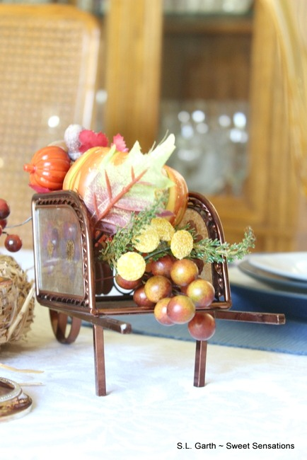 This non-traditional color palette lightens the feel of this Contemporary Fall Tablescape that is a part of the Autumn 2016 Tablescape Blog Hop.