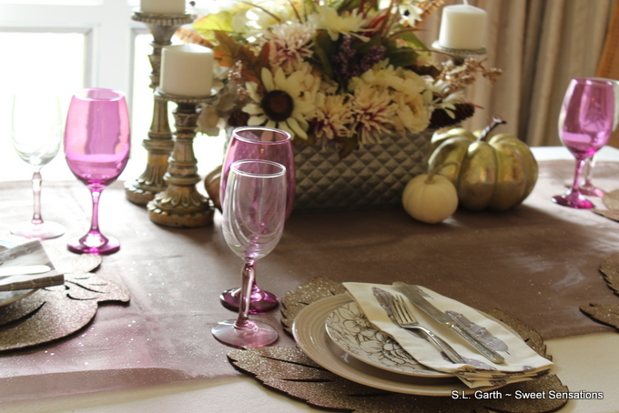 The non-traditional color palette of this Floral and Feathers Thanksgiving Tablescape gives it a more contemporary feel.