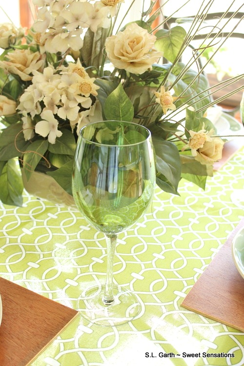 This casual green and white spring tablescape gave me the opportunity to take a break from my usual tablescape location.